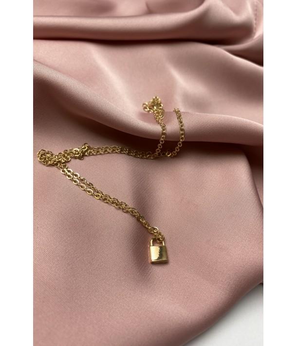 Тонкий золотий ланцюжок з підвіскою замок