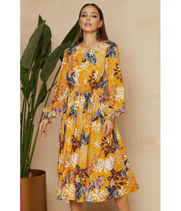 Помаранчева сукня з принтом в квіти в довжині міді