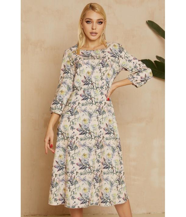 Персикова сукня міді з квітковим принтом