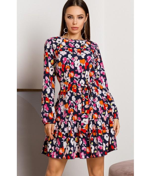 Темно-синя сукня з воланом по низу в квітковий принт
